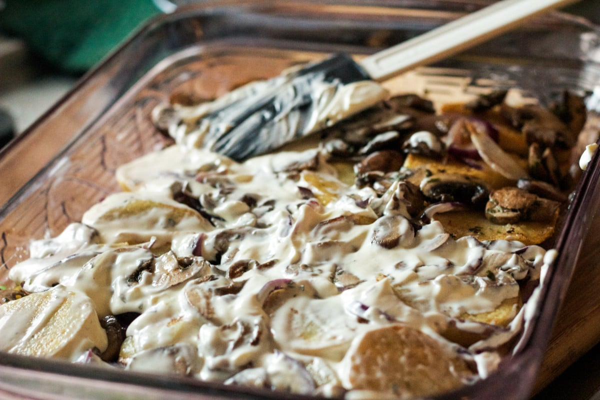 Top down view of potatoes with mushrooms and sauce