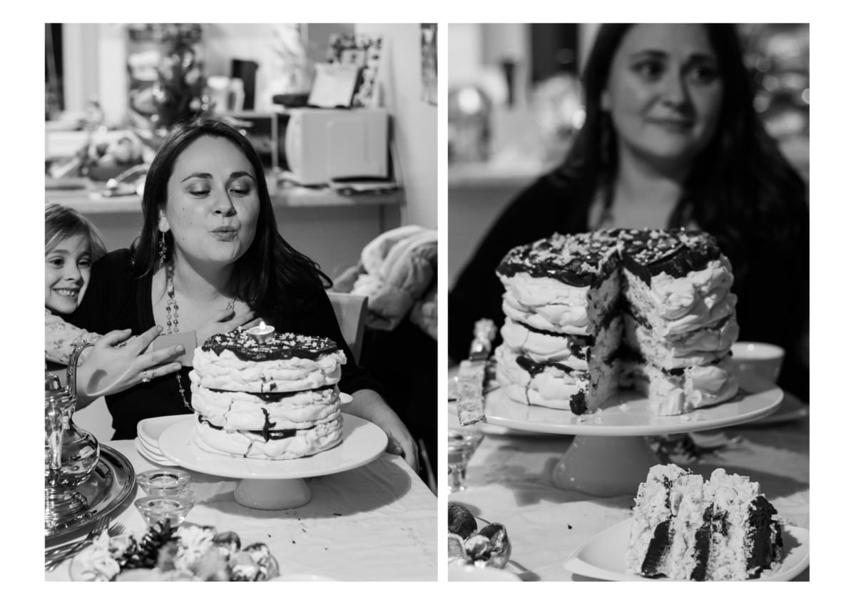Woman standing behind cut open meringue cake