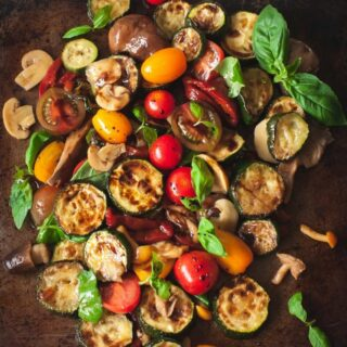 warm zucchini salad with cherry tomatoes, peppers and mushrooms
