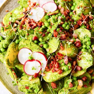 Pesto potato salad with radishes, peas and bacon