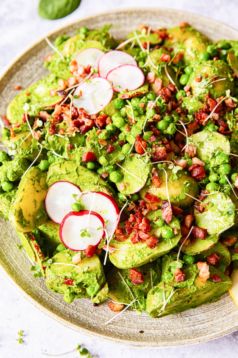 Pesto potato salad with radishes, peas and bacon