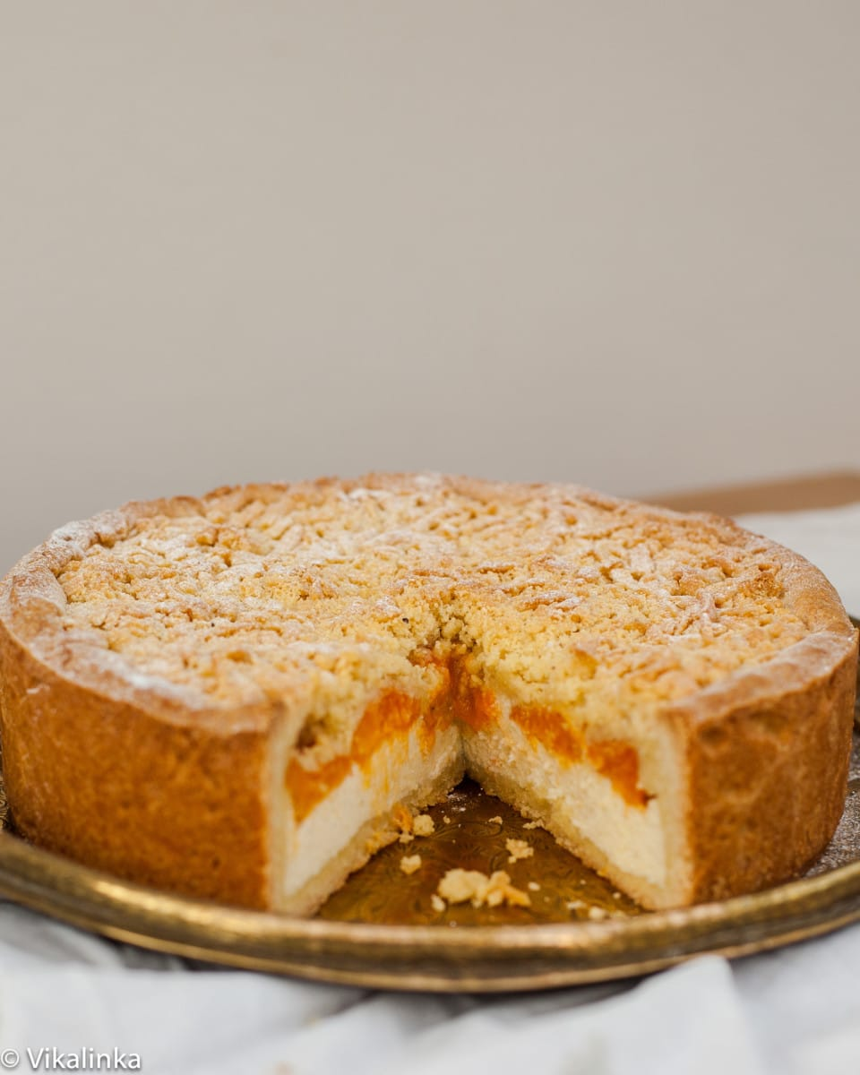 Apricot cheesecake with one slice removed