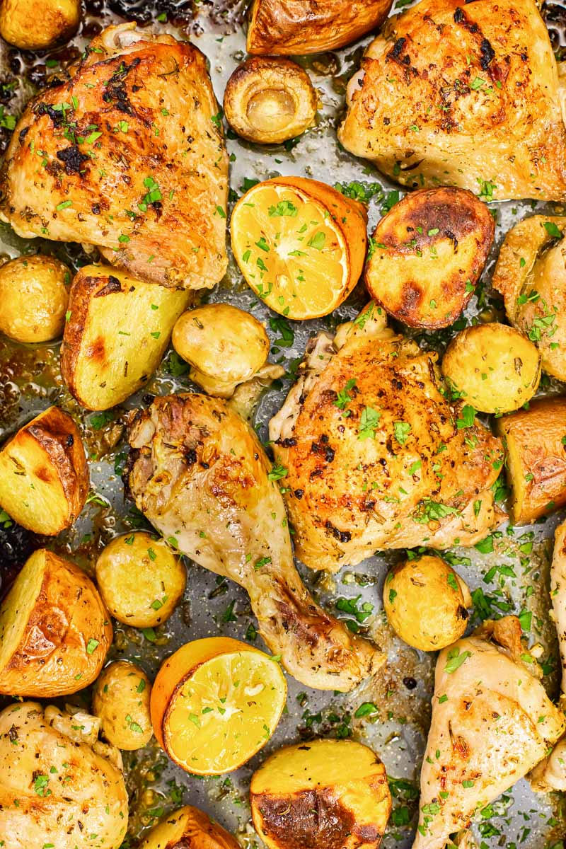 roasted chicken and potatoes with lemon, rosemary and mushrooms