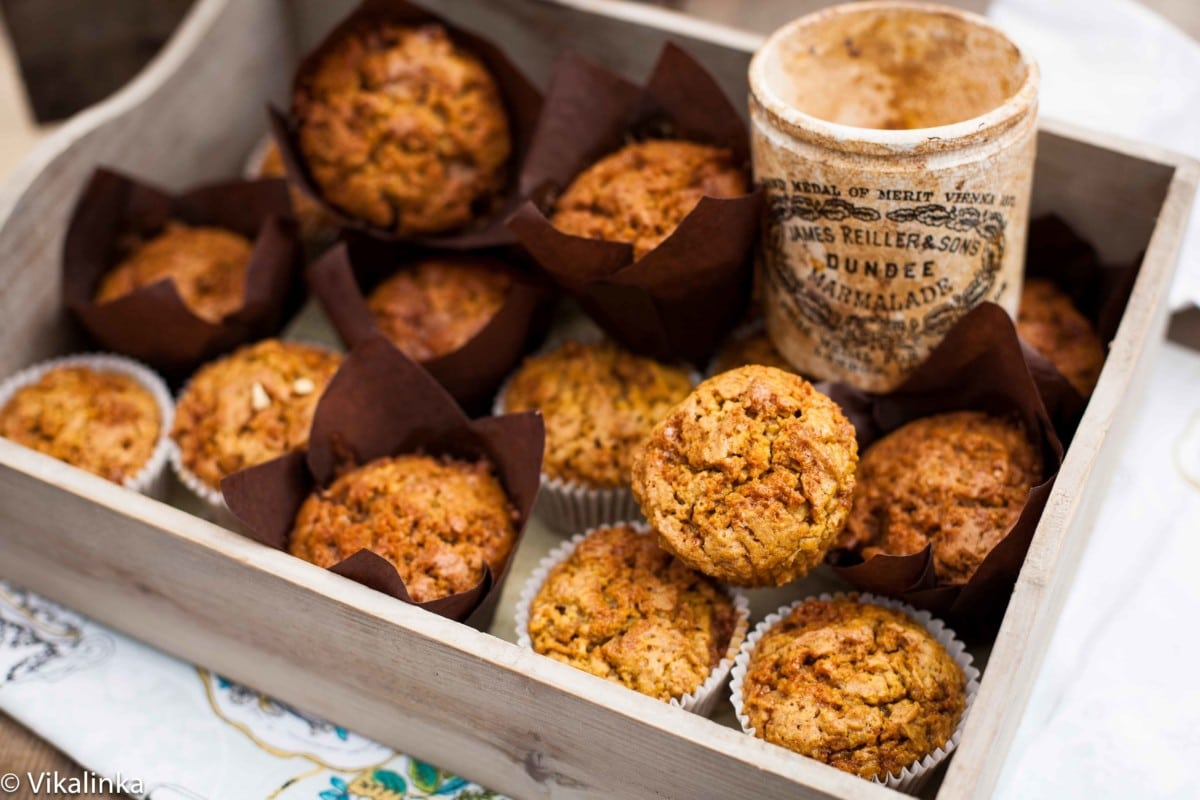Multiple toffee pumpkin muffins in wooden box with jar of toffee