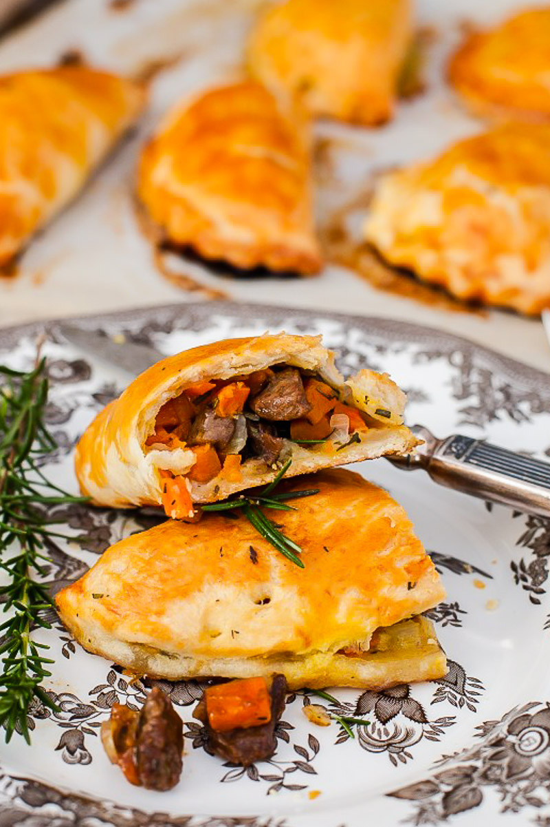 Cornish pasty broken into two on a plate