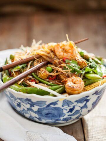 Shrimp Stir Fry in white and blue bowl.