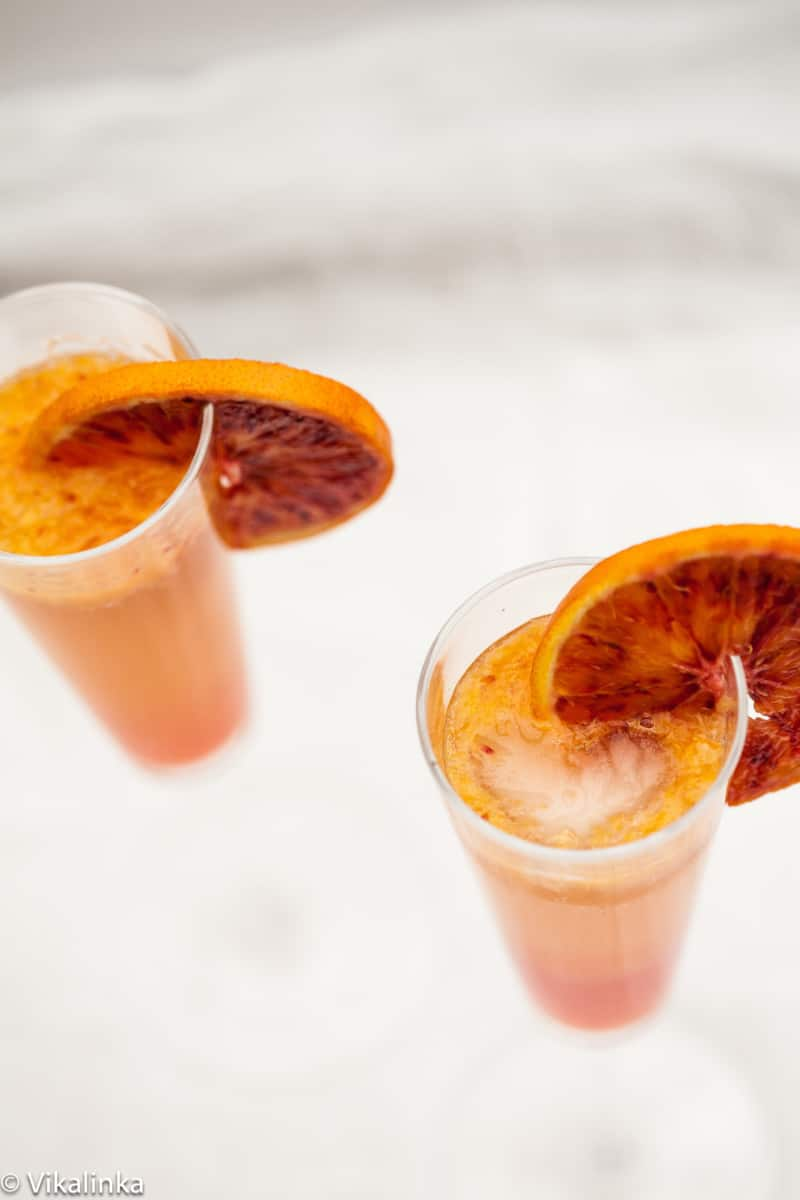 top down view of orange coloured cocktails