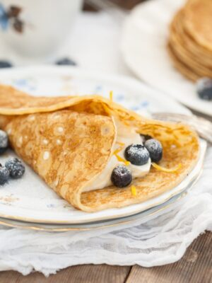 blintzes with sweet cheese filling and blueberries