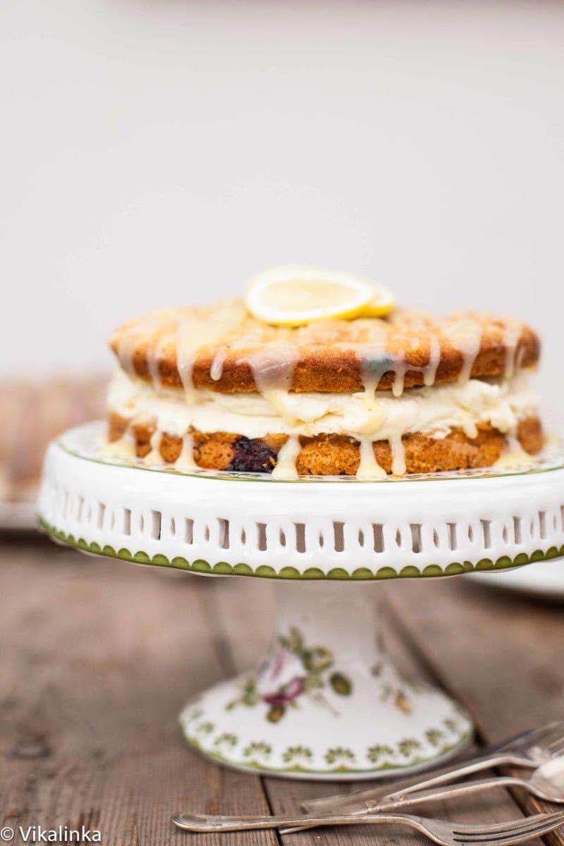 Raspberry limoncello cake on white stand