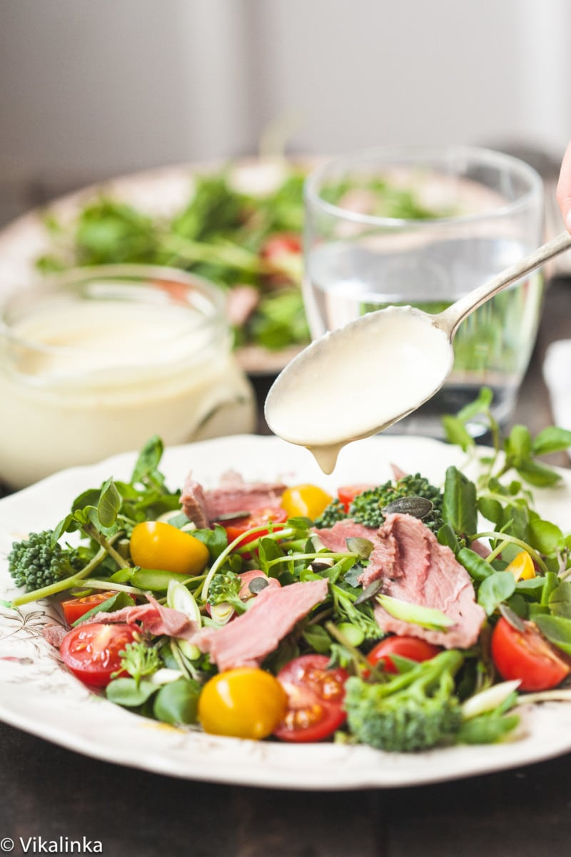 watercress salad with roast beef on a plate