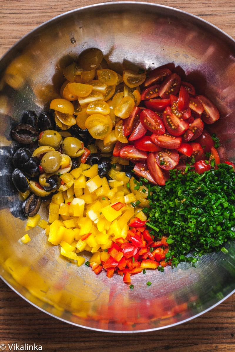 pasta salad ingredients in metal bowl