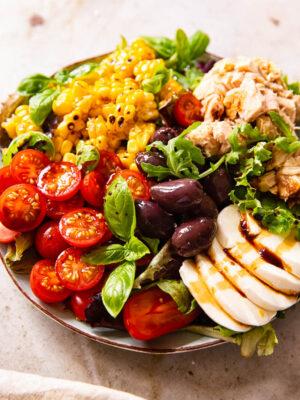 Italian Salad with cherry tomatoes, tuna, corn, olives and fresh mozzarella
