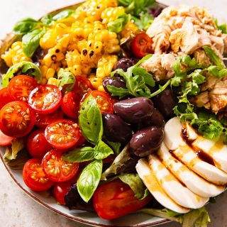 Italian Salad with cherry tomatoes, tuna, corn, olives and fresh mozzarella
