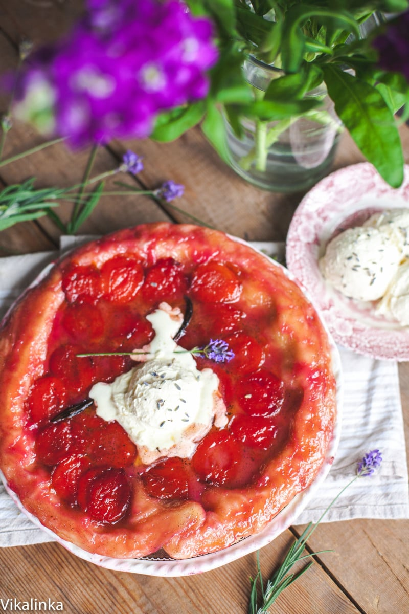 plum tarte tatin topped with melted cream