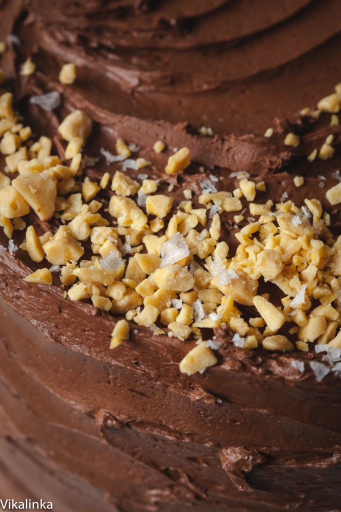 Chocolate cake with salted caramel buttercream with crushed honeycomb pieces and covered in dark chocolate ganache