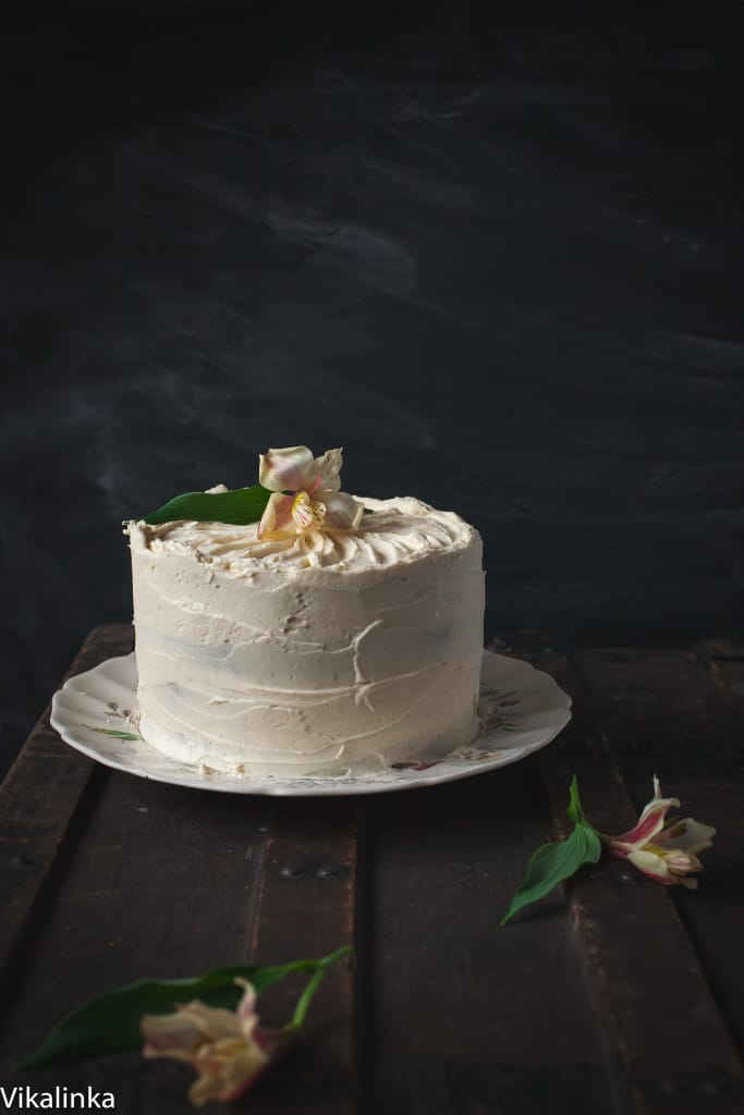 Side view of the pumpkin and chocolate cake against a dark background