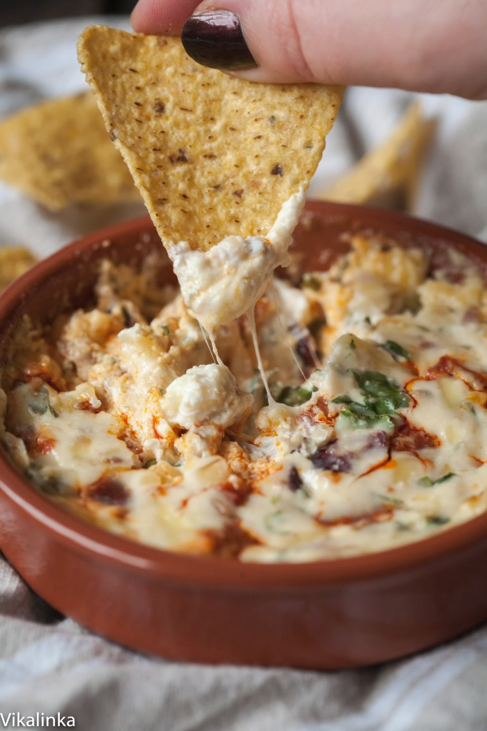 Creamy and smoky this dip has it all-a blend of 3 cheeses, smoky chorizo and festive cranberries. Bring out the dunkers!