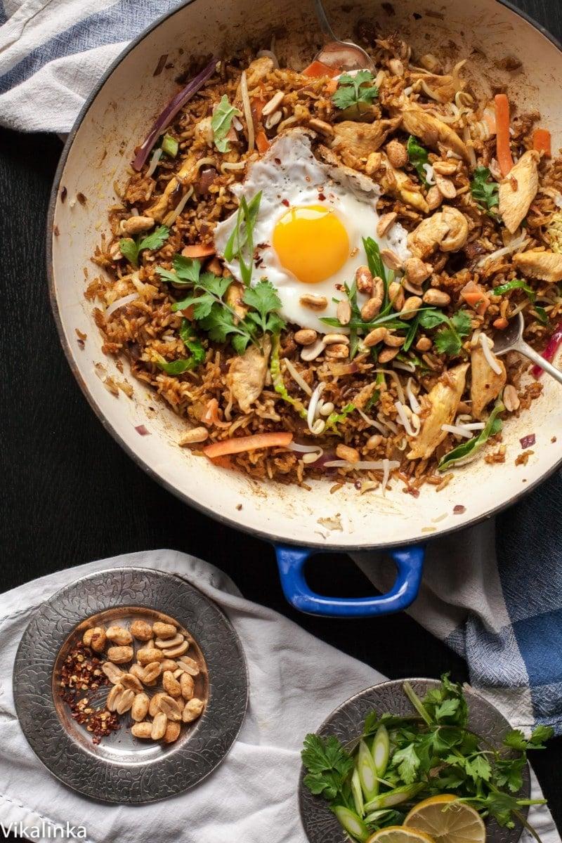 TNasi Goreng in a pan next to dish of peanuts
