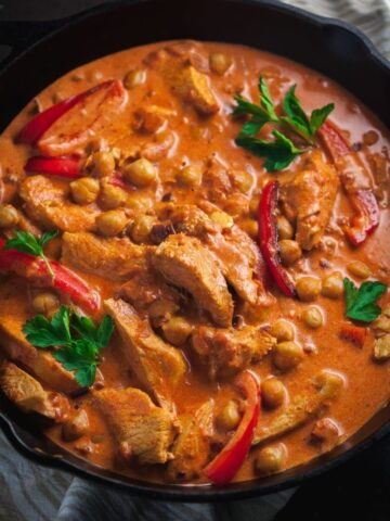 chicken and chickpea paprikash in cast iron skillet