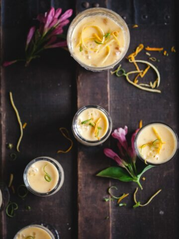 lemon posset in glasses on dark background