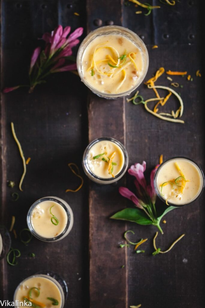 lemon posset in glasses on dark background