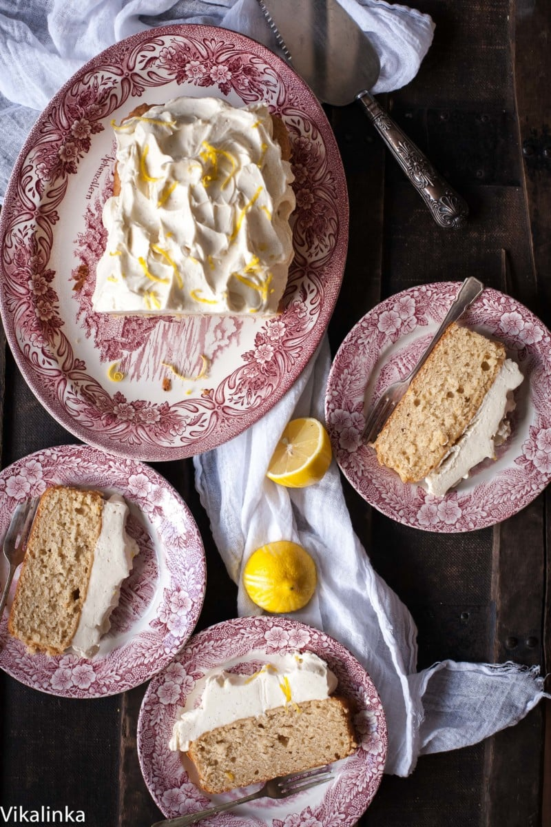 Lemon Ricotta Loaf Cake with a mound of Cream Cheese Frosting.