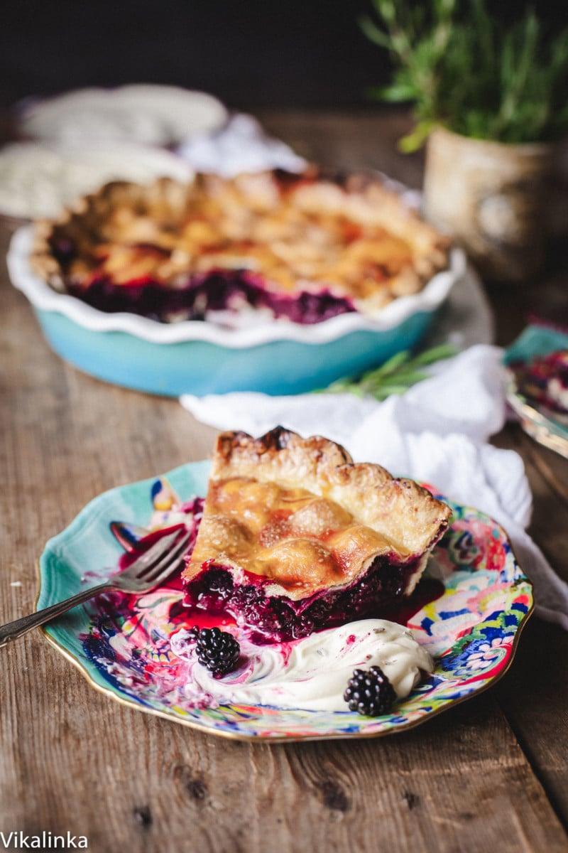 Piece of wild blackberry pie with dollop of creme fraiche