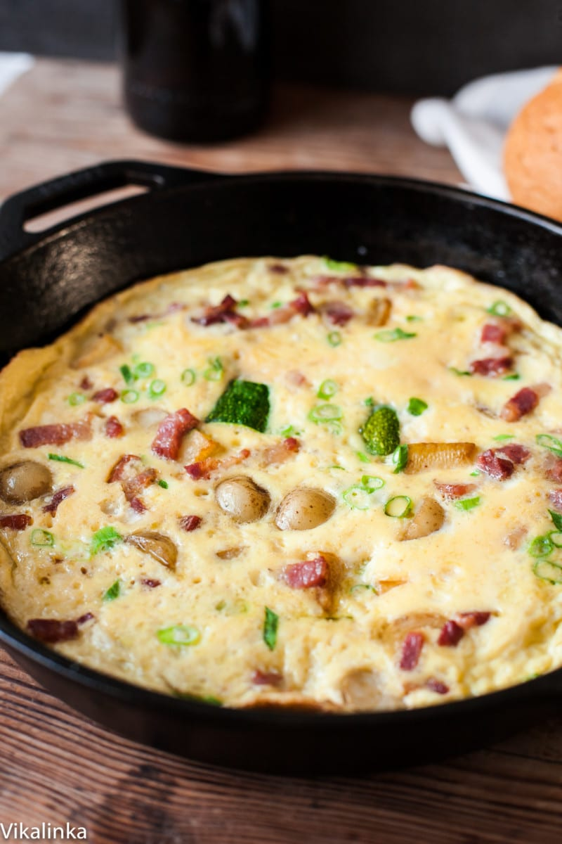 omelette with bacon and potatoes in a pan