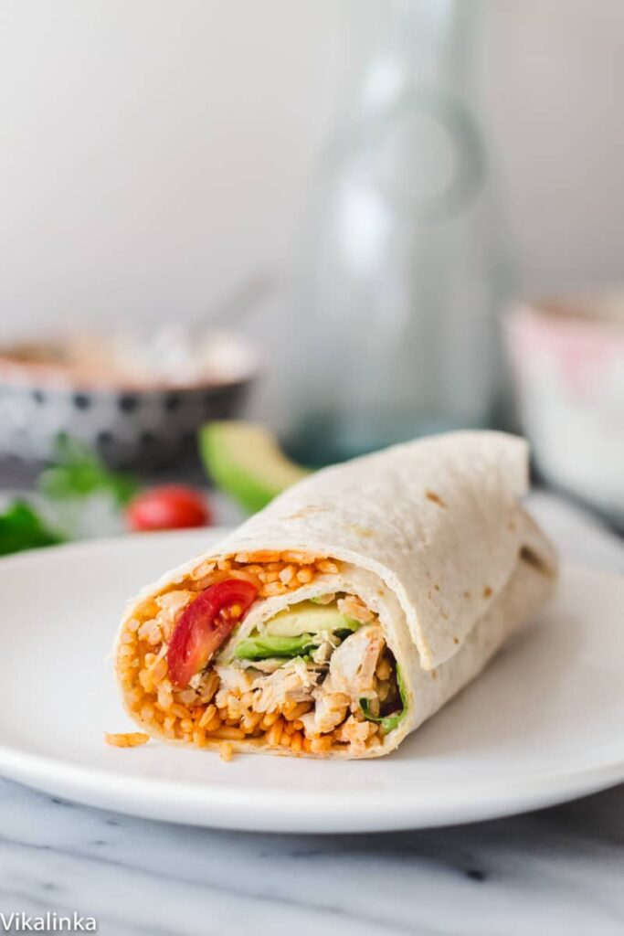 Delicious Peri Peri Rice and Chicken Wrap with Avocado and Spicy Yogurt Sauce. Your lunch just got very exciting!