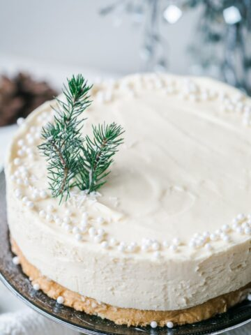 Cake with beads and a small piece of evergreen