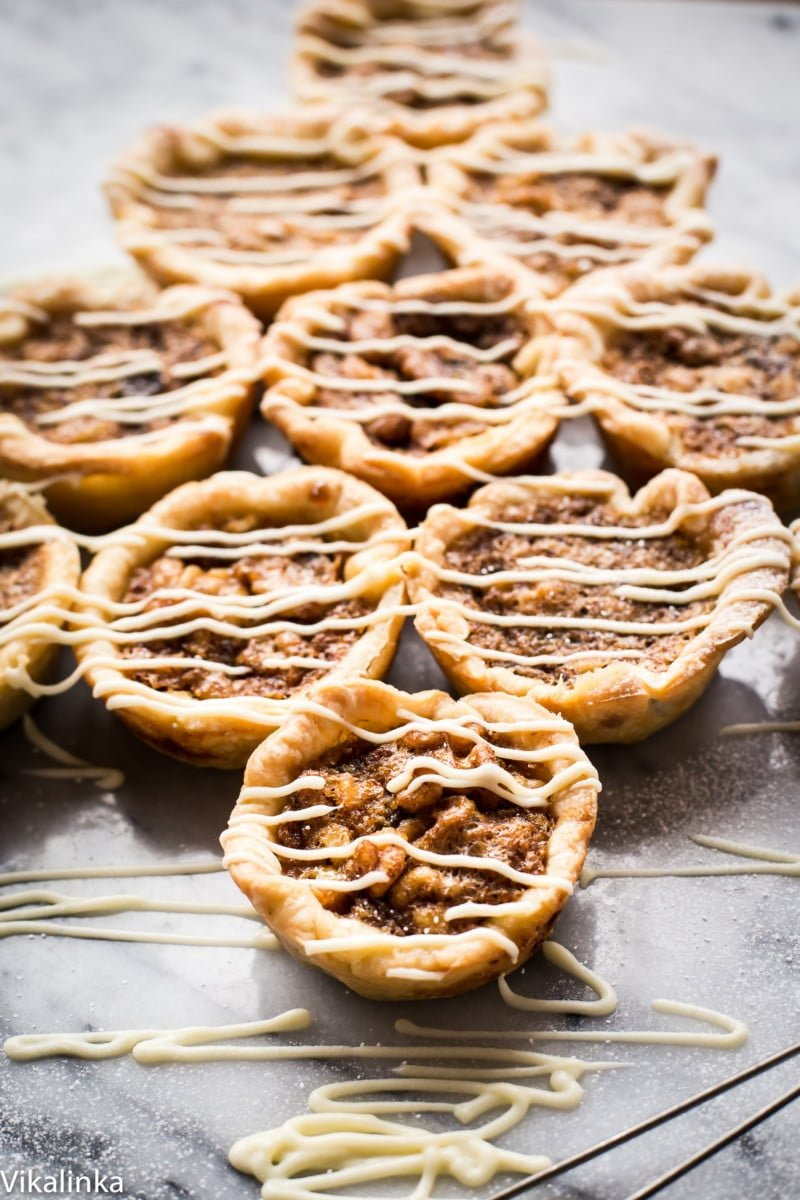 butter tarts drizzled with white chocolate