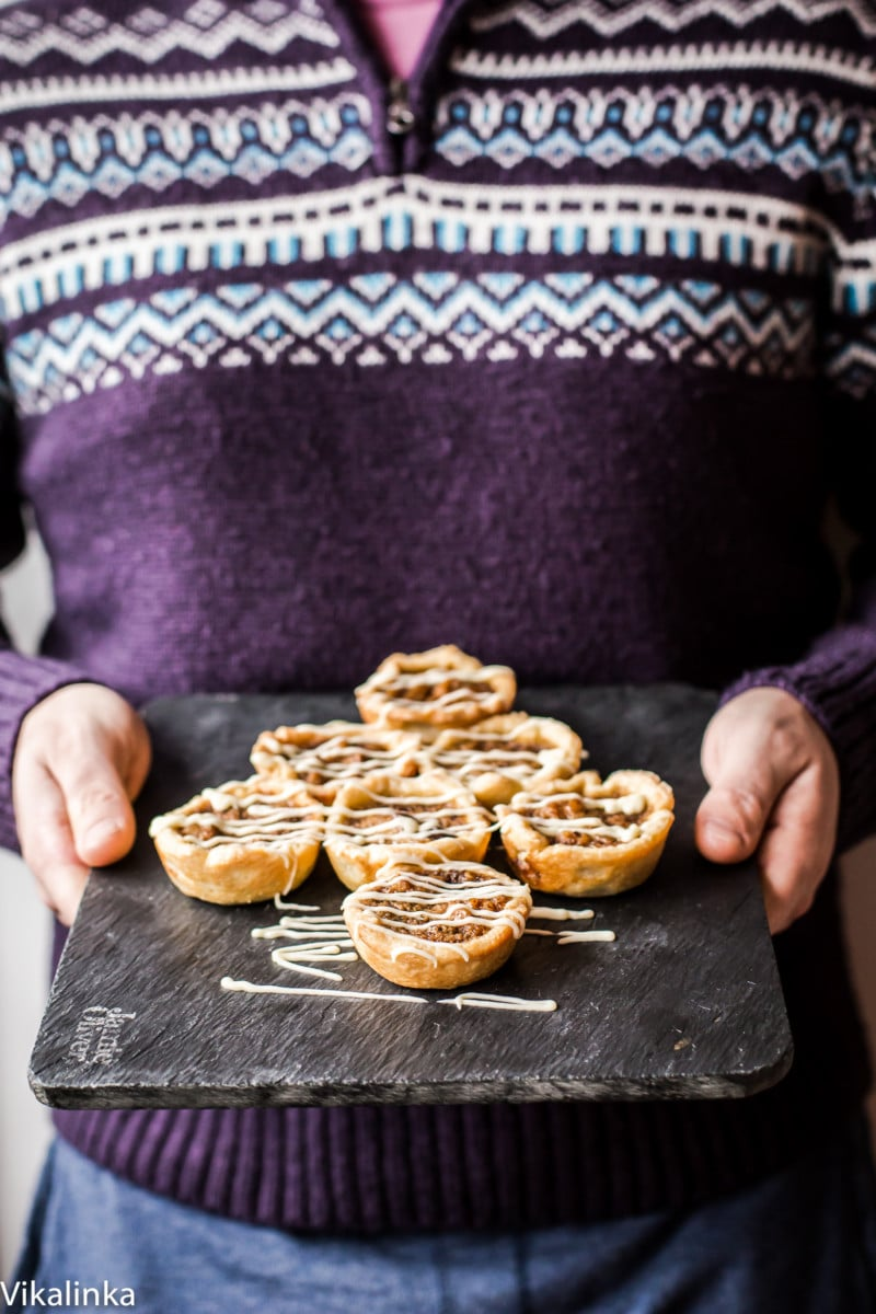 Butter Tarts-flaky pastry tartlets filled with delicious golden custard, raisins and walnuts.