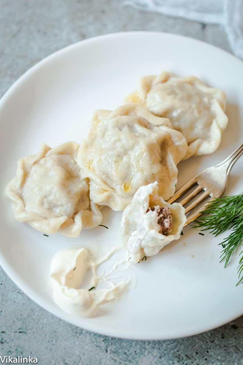 These delicate meat dumplings Pelmeni served with sour cream will become the highlight of your week!