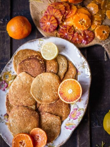 pancakes with citrus fruit on platter