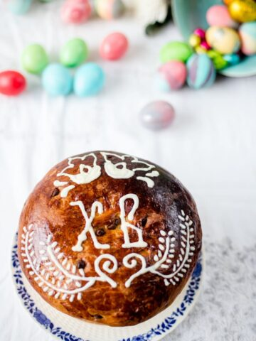Easter Bread Kulich and Easter eggs in the background