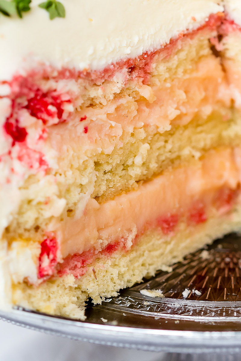 close up of vanilla sponge cake with rhubarb curd filling