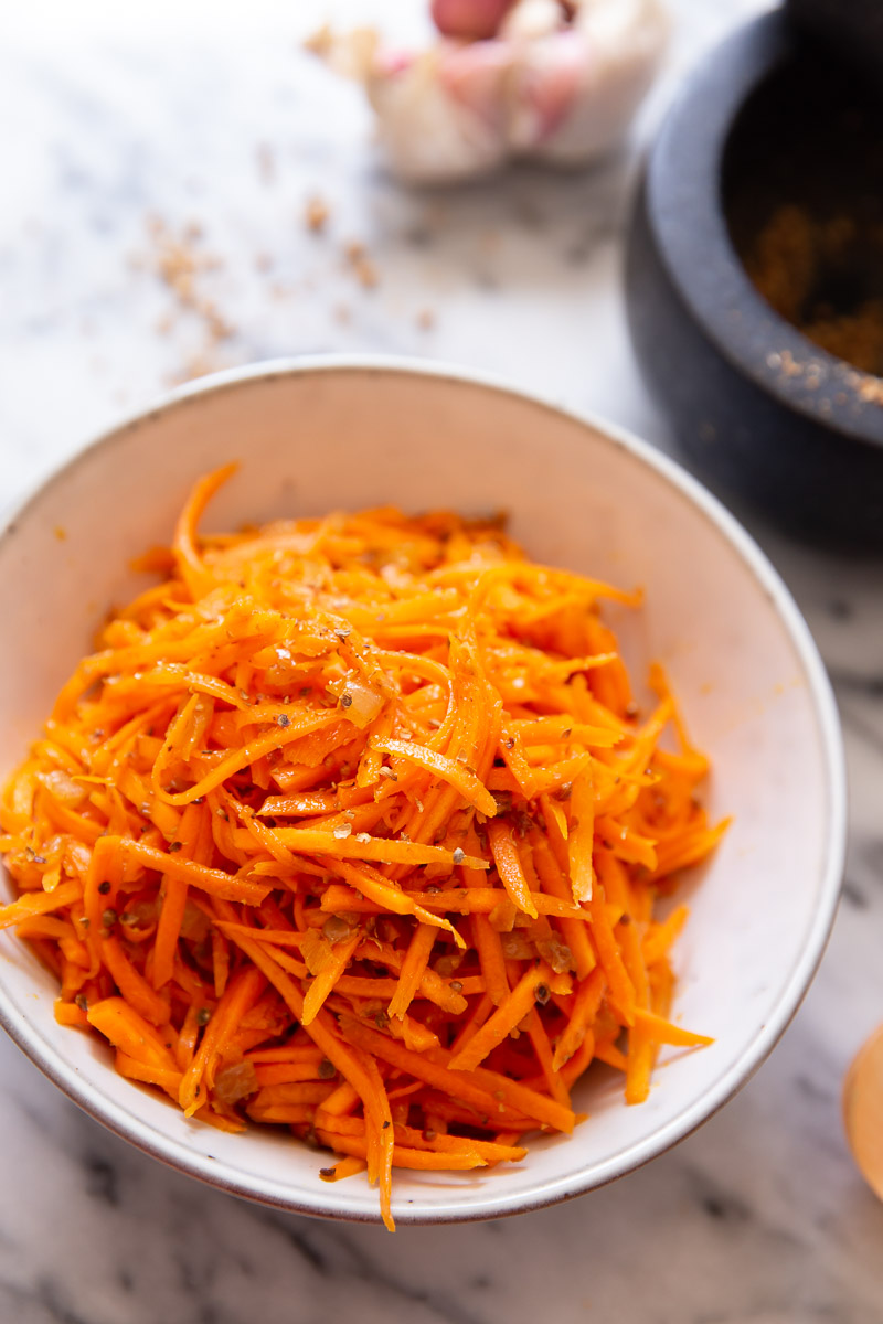 Korean carrot salad in white bowl