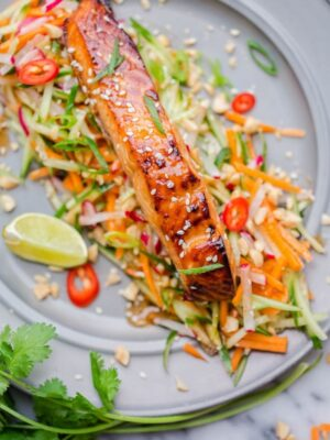 Asian glazed salmon on top of carrot and cucumber slaw with lime and chillies.