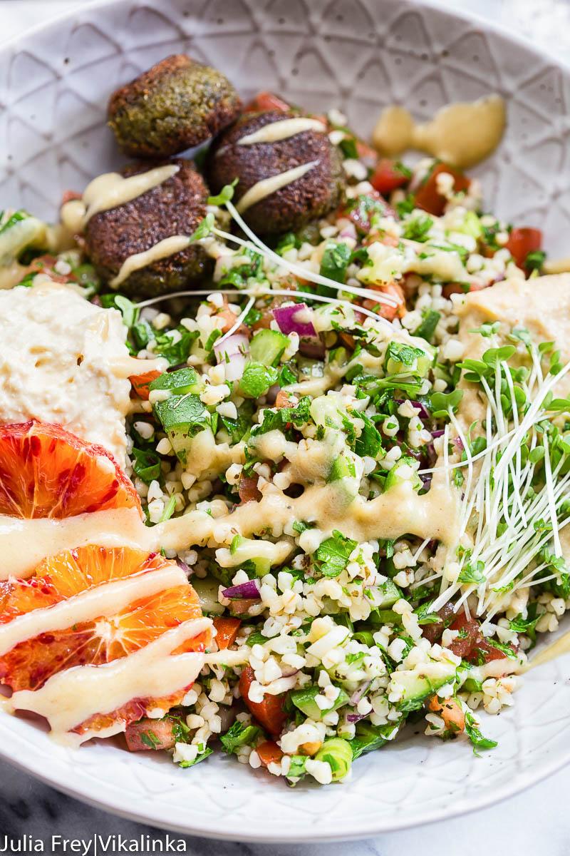 tabbouleh, hummus and falafel in a bowl