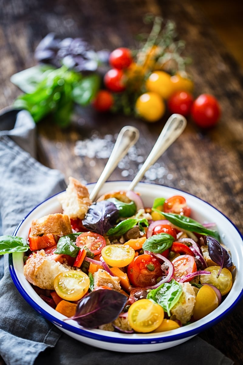 Tuscan Panzanella Salad in white bowl with blue rim