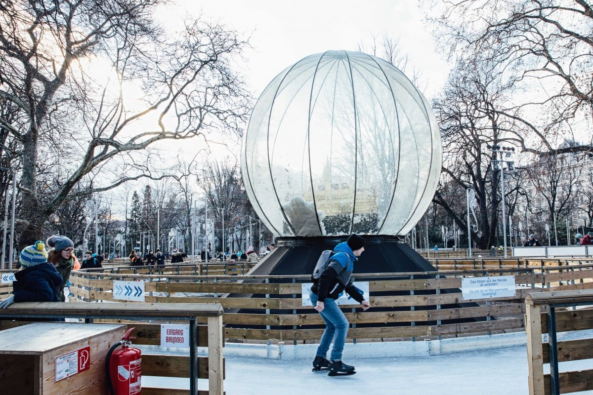 Skater and giant snowglobe at Rathousplatz Christmas Market