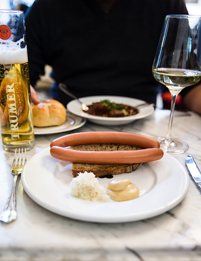Cafe lunch with sausage, wine and beer