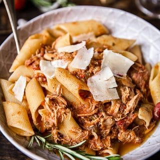 Bowl of the pasta dish with cheese shavings