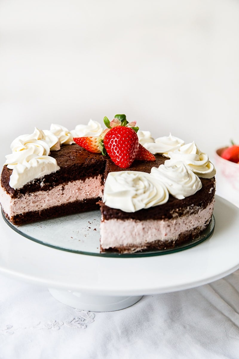 Dark chocolate sponge layers sandwiched together with a light and creamy strawberry mousse.