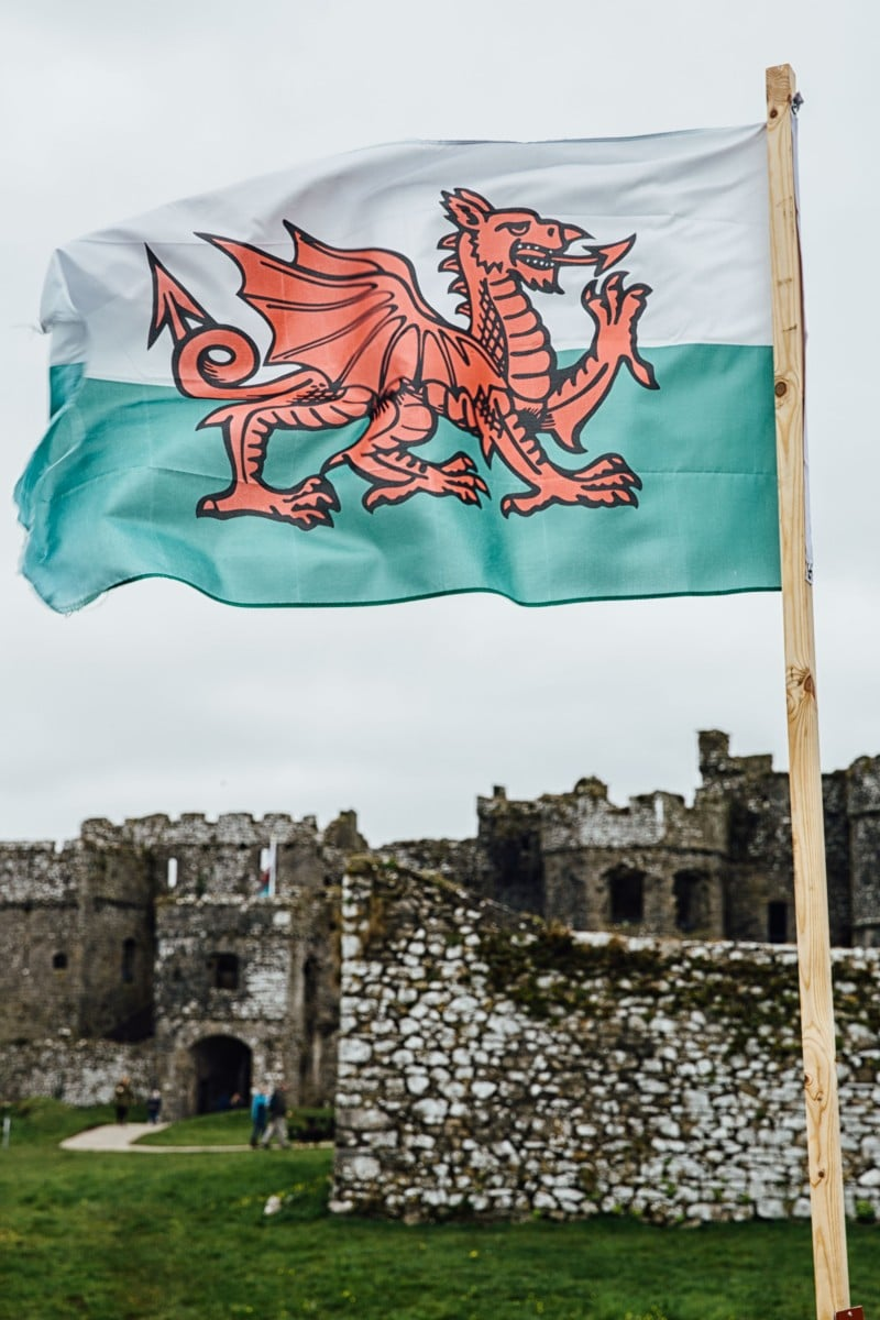 Welsh flag in front of Carew Castle
