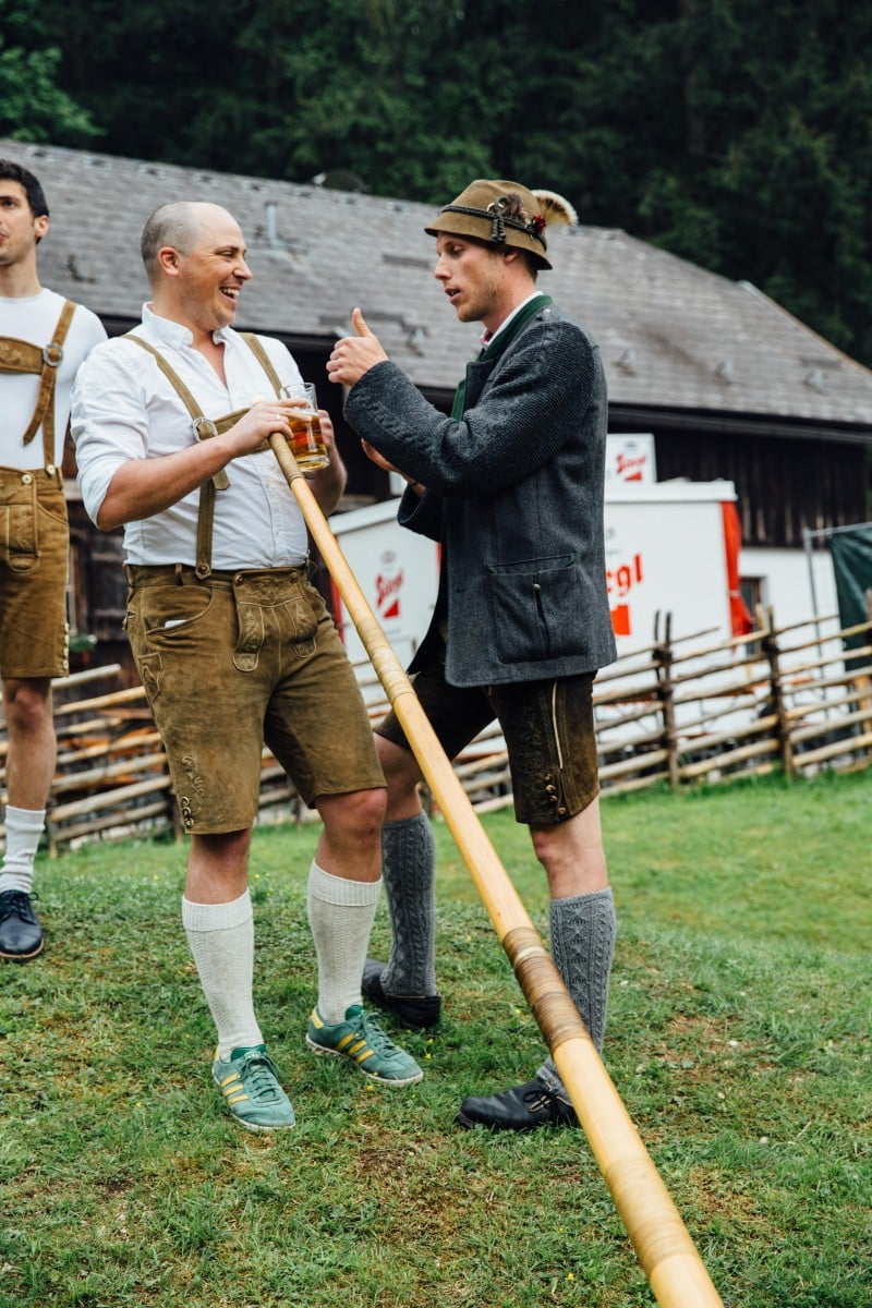 Brad learning the alphorn with help from Austrian in lederhosen