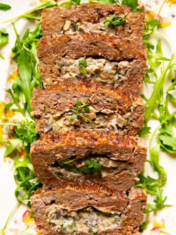 Meatloaf stuffed with creamed mushrooms with herbs and garlic.