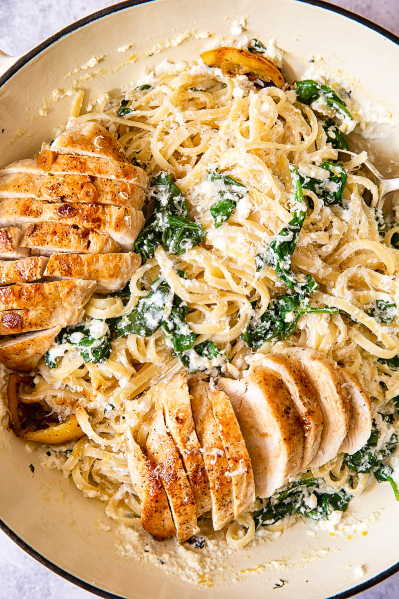 Ricotta pasta with spinach and lemon sliced butter chicken breast