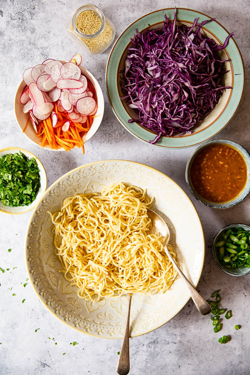 Ingredients in bowls for Asian Noodle Salad