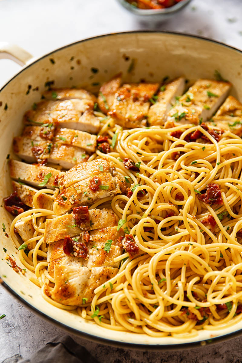Spaghetti tossed with sun-dried tomatoes, garlic and chillies and sliced chicken breasts.